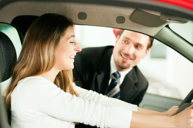 Woman buying a car in