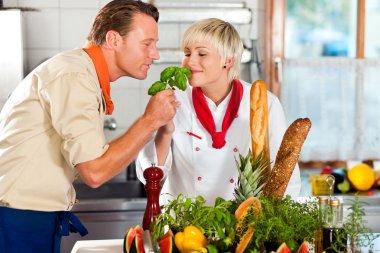 Two chefs in teamwork - man
