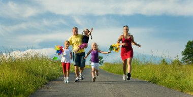 Family with three kids running