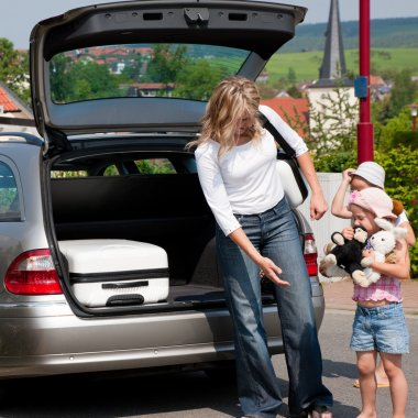 Family travelling by car returning from vacation