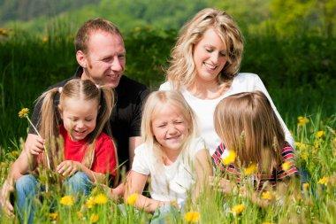 Very happy family with three