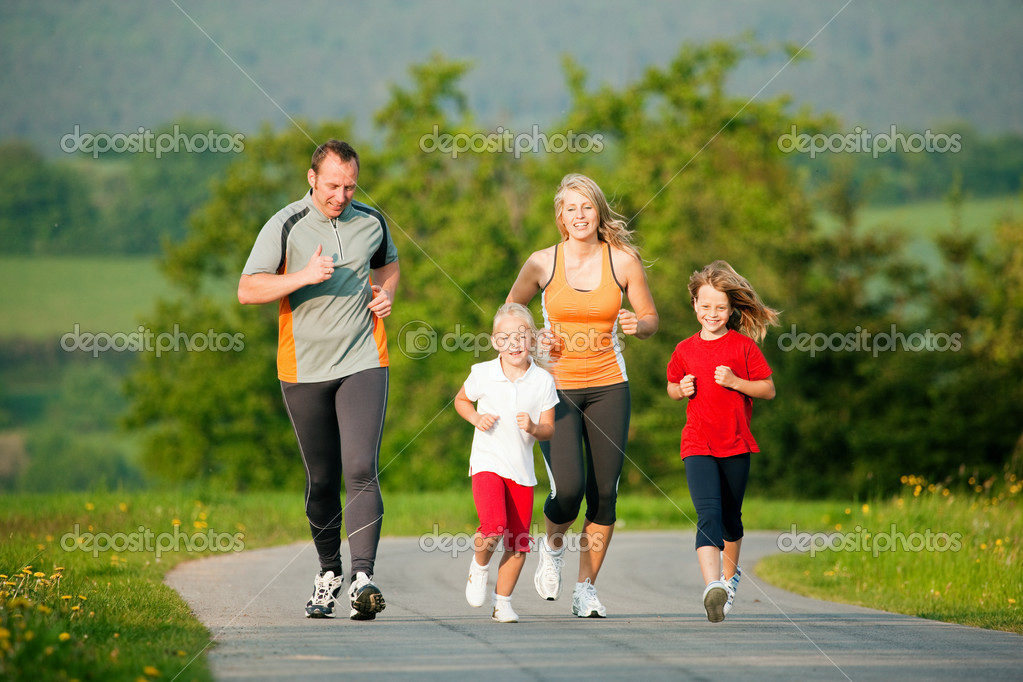 Family jogging outdoors with