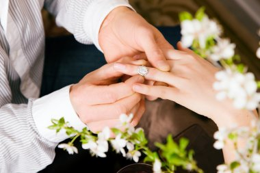 Couple - he is proposing