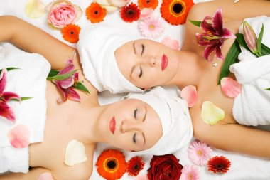 Two girls relaxing in a wellness