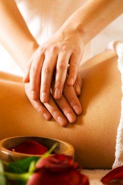 Woman enjoying a massage in a