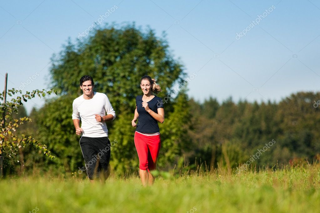 Young fitness couple doing