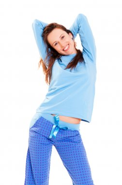 Happy cute woman in blue pyjamas