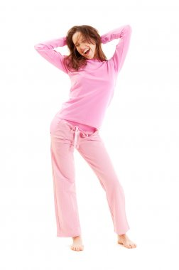 Happy young woman in pyjamas