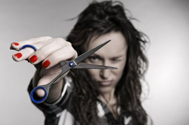 Attractive hairdresser with scissors
