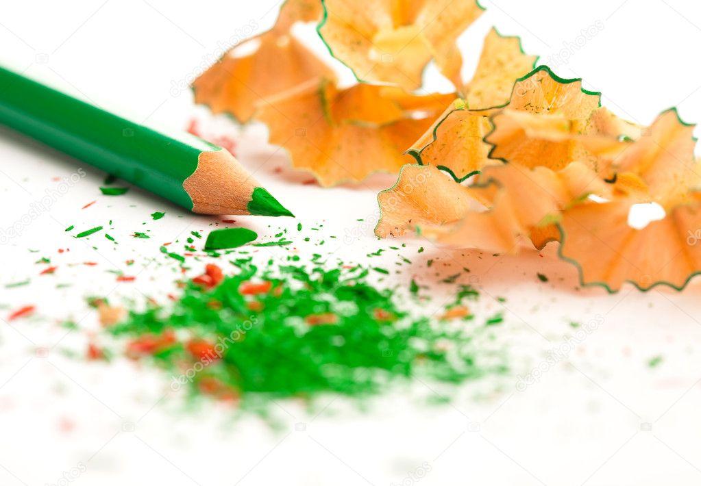 Crayon shaving over white stock vector