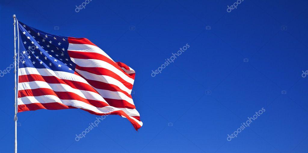 American flag fluttering in blue sky 1