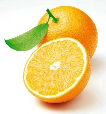 Two freshly cut oranges with a leaf