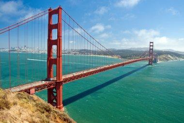 The Golden Bridge in San Francisco with beautiful azure ocean in background stock vector