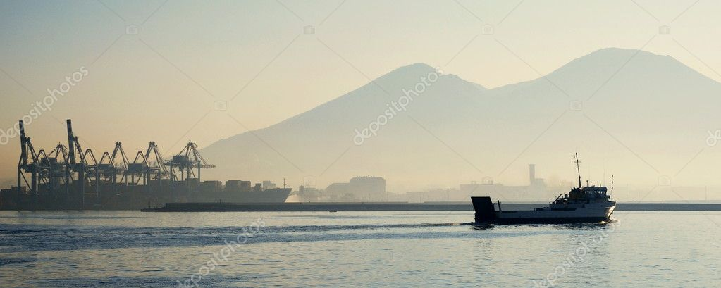 Ferry on a sea with Mount Vesuvius and cranes