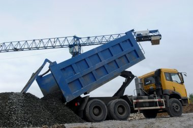 Truck transporting building materials during the working process