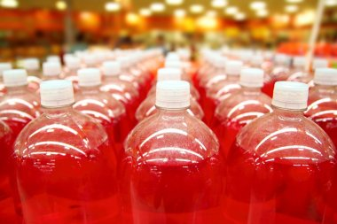 Assembly line bottle red liquid rows lines