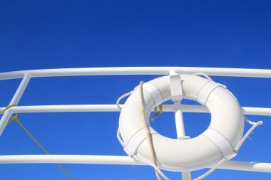 Boat buoy white hanged in railing summer blue sky