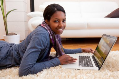 Young black woman using a laptop