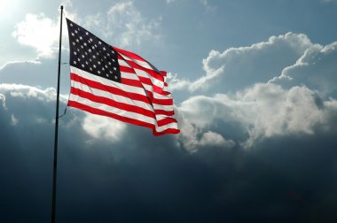 American Flag Against Stormy Skies