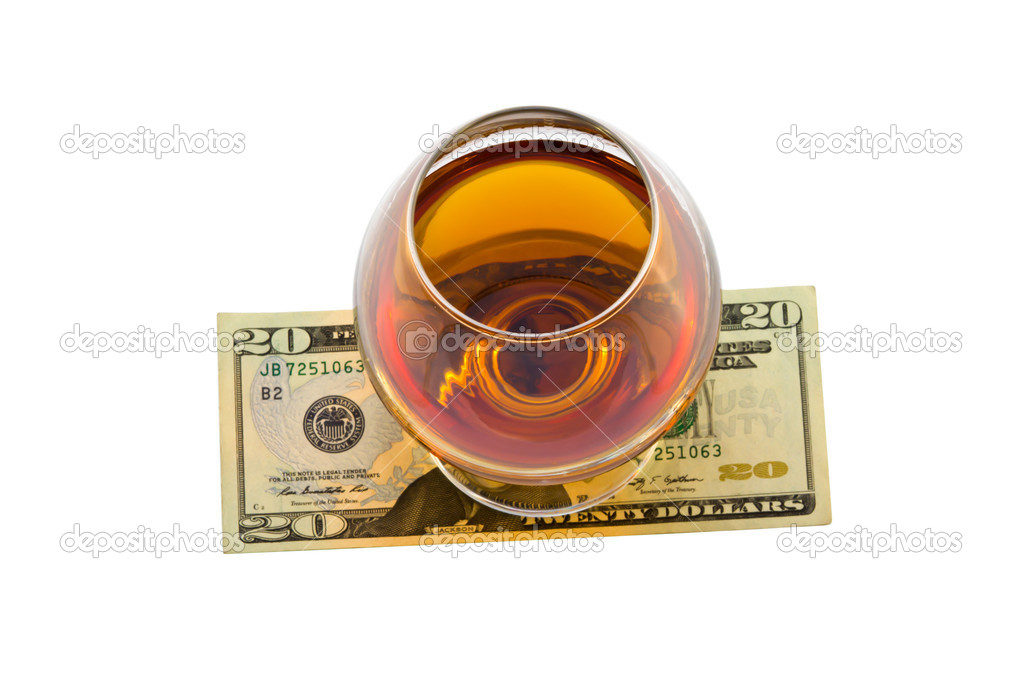 Glass of alcohol with dollar