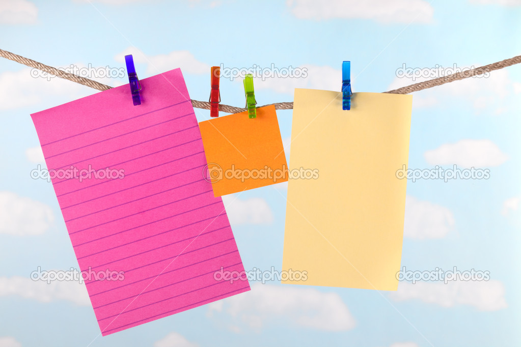 Pink, yellow and orange note paper on clothesline