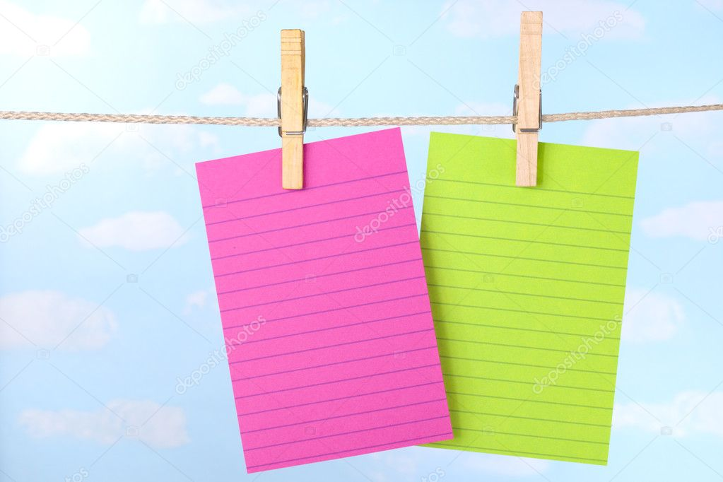 Pink and green notes on clothesline