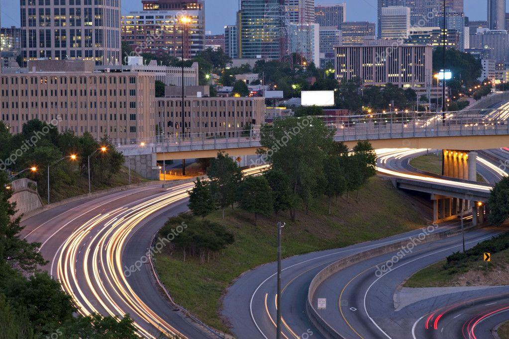 Atlanta twilight skyline showing traffic streaks