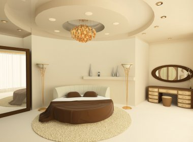 Round bed with a suspended ceiling in a luxurious bedroom