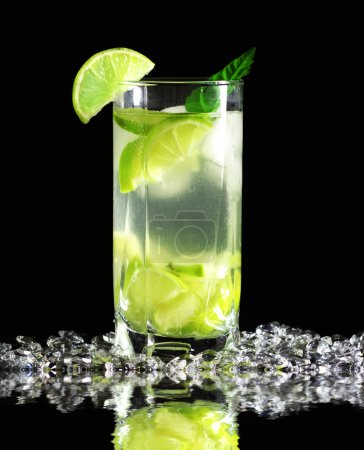 Mojito cocktail with fresh limes on a black background