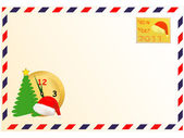 Christmas tree a dial a cap of Santa Claus and a stamp located against an envelope of aviation mail