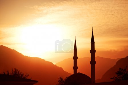 Photo for Mosque silhouette at sunset, with mountains on background, Turkey, Kemer - Royalty Free Image