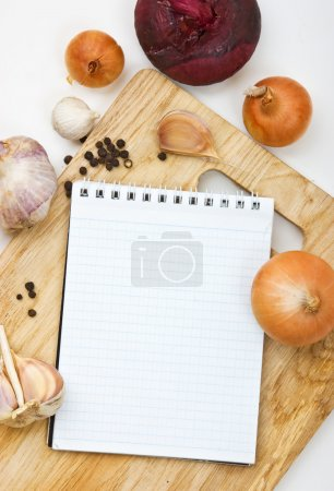 Photo for Notebook for culinary recipes on a cutting board - Royalty Free Image