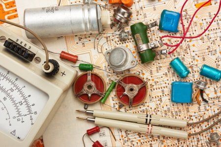 Photo for Multimeter and electronic components on circuit - Royalty Free Image