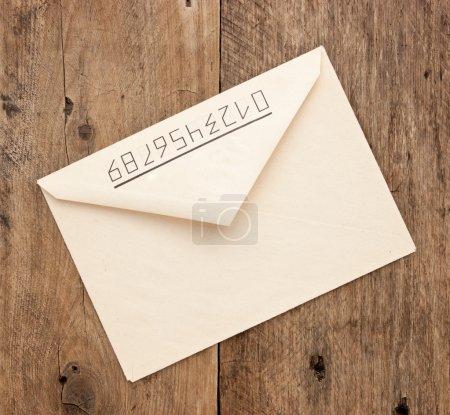 Photo for Old postal envelope on wooden background - Royalty Free Image