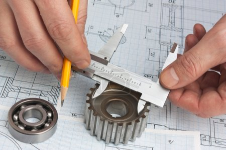 Photo for Technical drawing and tools in hand - Royalty Free Image