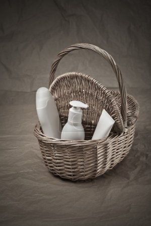 Basket with bottles and tube