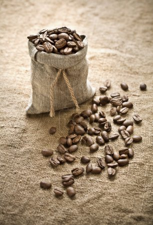Coffee beans in bag on sacking