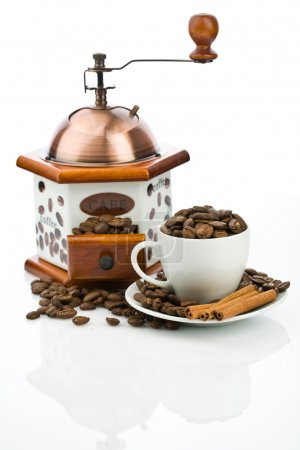 Cup and mill with beans isolated