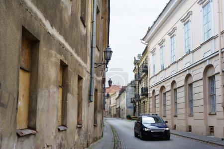 Modern car in narrow paved street