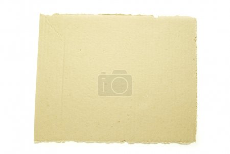 Photo for Ripped piece of cardboard on white - Royalty Free Image