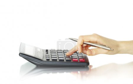Photo pour Calculatrice avec main isolée sur blanc - image libre de droit