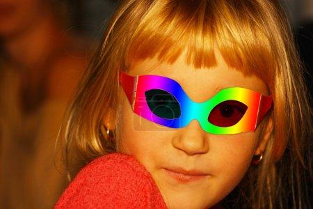 Girl in a masquerade mask