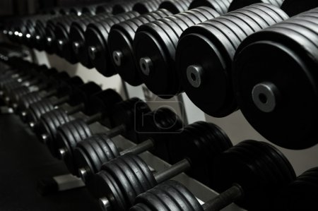 Photo for Heavy sports dumbbells in modern sports club - Royalty Free Image