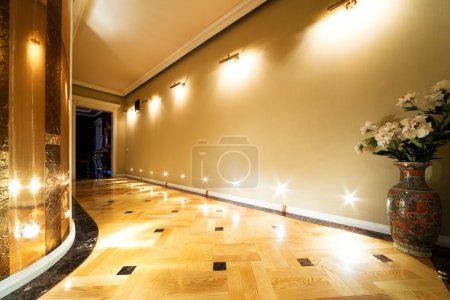 Photo for Flowers in a long hallway with parquet flooring - Royalty Free Image