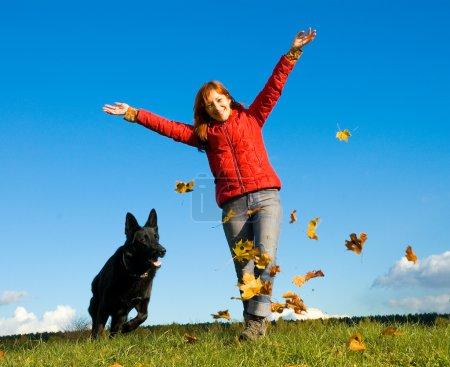 Woman with a big black dog