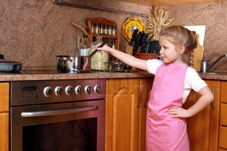 Girl cooking in the Kitchen