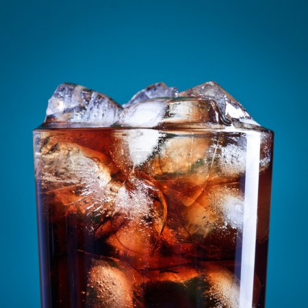 Photo for Glass of cola with ice on blue background - Royalty Free Image