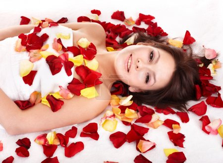 Photo for Young beautiful woman on massage table in beauty spa. - Royalty Free Image