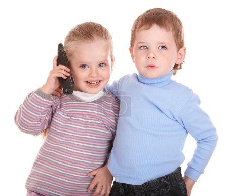 Children speaking by phone.