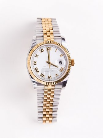 Gold and stainless steel mans watch